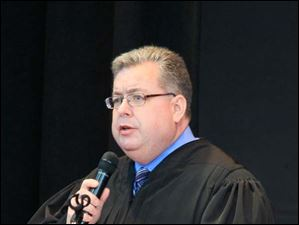 U.S. District Court Judge James R. Knepp addresses 29 people who are to become new U.S. citizens.