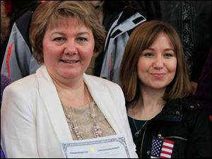 Mariana Steffan,left, and her daughter Anna Cook, 29, of Akron, both originally of Russia, are all smiles after the naturalization ceremony.