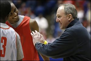 Ohio State head coach Thad Matta talks with his players during practice Thursday in Dayton, Ohio. Ohio State is scheduled to play Iona today.