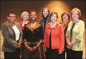 YWCA Milestone honorees were, from left, Linda Brown-Ewing, Teresa Fedor, Wanda Butts, Dr. Anne Towey Ruch, Patricia Kirchner Appold, Carolyn M. Putney, and Dr. Jane H. Robinson.