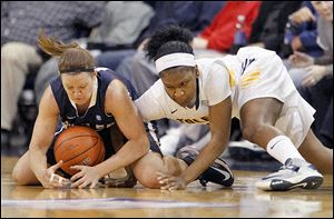 Butler's Mandy McDivitt, left, and UT's Lecretia Smith battle for the ball in Thursday night's WNIT game at Savage Arena.