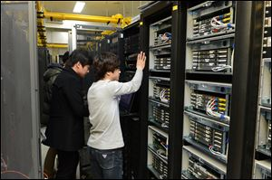 In this photo released by Korean Broadcasting System, KBS employees try to recover a computer server a day after a cyberattack caused computer networks at the company to crash,  in Seoul, South Korea, today.