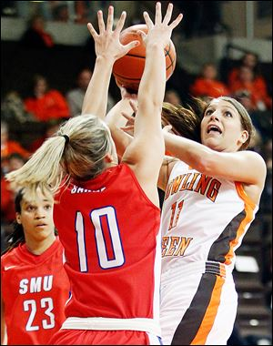 Bowling Green's Jillian Halfhill puts up a shot against  SMU's Korina Baker during a WNIT game at Bowling Green. Halfhill led the Falcons with 23 points. BG will plays Duquesne on Saturday.