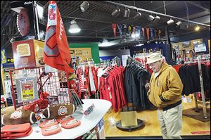 Jerry Reiter of Toledo shops at The Buckeye Store and More! Manager Al Luna said his store sees a 10 to 15 percent increase during March Madness.