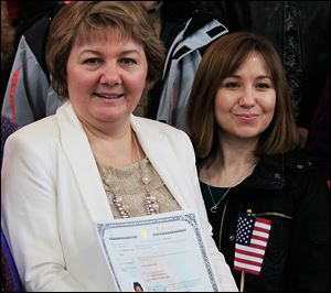 Mariana Y Steffan, left, with daughter Anna Cook, 29, both of Russia, holds her certificate after the event. Ms. Steffan teaches music for elementary and middle school students.