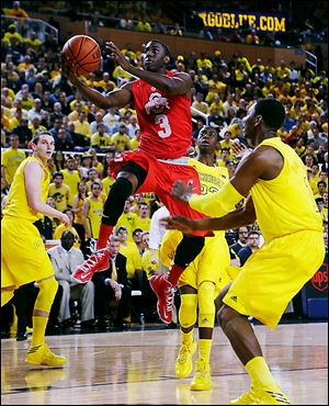 Ohio State sophomore Shannon Scott drives the lane against Michigan. Scott was voted to the  All-Big Ten defensive team. His father, Charlie, was the first African-American scholarship athlete at North Carolina and won and NBA title when he played for the Boston Celtics.