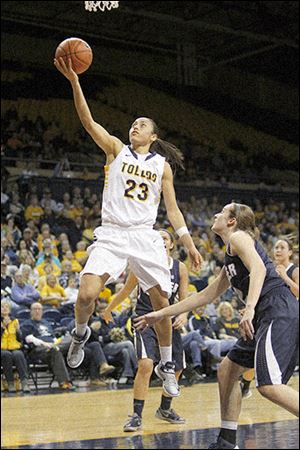 University of Toledo's Inma Zanoguera drives to the hoop for a basket during the first half against Butler's Blair Langlois. She scored 16 points.