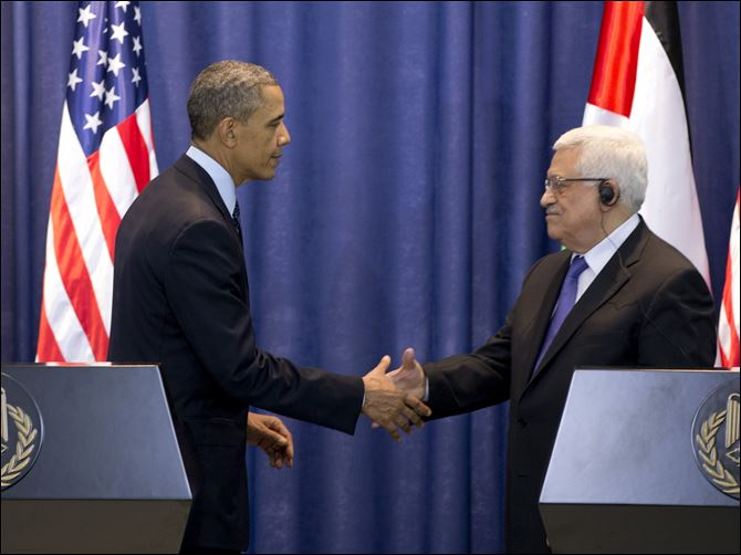 Mideast Israel Palestinians Obama President Barack Obama and Palestinian President Mahmoud Abbas shake hands during a joint news conference at the Muqata Presidential Compound, in the West Bank town of Ramallah, today.