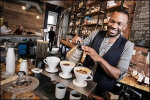 Ryan Barrett makes pour-over coffee at Great Lakes Coffee Roasting Co., which opened on Woodward Avenue in July.