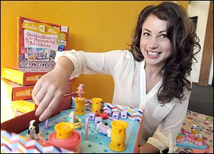 Debbie Sterling, founder of GoldieBlox, demonstrates how to play her new toy for girls in Oakland, Calif. Girls will be able to build projects along with Goldie and her animal friends.