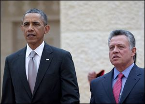President Barack Obama walks with Jordan's King Abdullah II to participate in an official arrival ceremony at Al-Hummar Palace, the residence of Jordanian King Abdullah II, in Amman, Jordan.