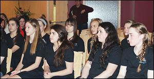 St. Ursula Academy choir members assemble in the school's chapel on Friday where they prayed for a safe trip to New York City and to perform at their best in the competition at Carnegie Hall. The choir was treated to a stellar send-off reserved for competitors representing the all-girls' high school.