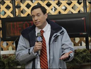 Chief meteorologist Jay Berschback gives the weather report outdoors.