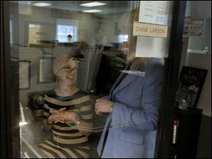 Anchor Diane Larson, left, jokes with reporter Lissa Guyton Thursday afternoon at WTVG offices in Toledo.
