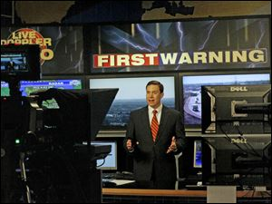 Chief meteorologist Jay Berschback gives the weather report.