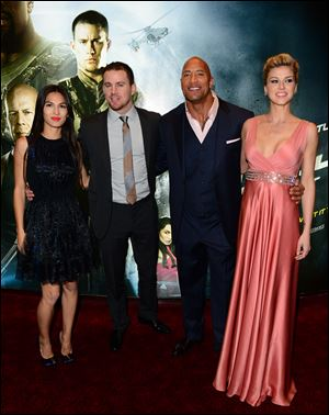 Elodie Yung, Channing Tatum, Dwayne 'The Rock' Johnson and Adrianne Palicki arrive at the UK Premiere of G.I. Joe: Retaliation at the Empire Leicester Square in London on Monday, March 18, 2013.