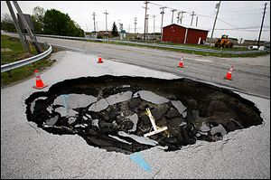 It can happen in this area too. In 2008, a large sinkhole at the intersection of State Rt. 64 and King Road closed Route 64 through nearby Haskins in Wood County.