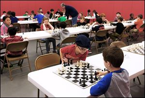 Timothy Atkinson, 6, of Bowling Green, left, and Calvin Mlcek, 7, of Monclova play in the K-2 section during the 2013 Great Lakes Chess Association Scholastic Open chess tournament.