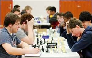 Bowling Green High School student Nick Van Vorhis, left, and Perrysburg High School student Ben Hirt battle in the open section. Chess clocks and notation were required in open section matches.