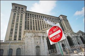 The Michigan Central Station sits desolate in Detroit, the most conspicuous of the city's thousands of derelict buildings.