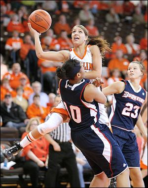 BG's Jillian Halfhill (11) is fouled by Duquesne's Wumi Agunbiade (10) during the first half of their WNIT game at the Stroh Center.