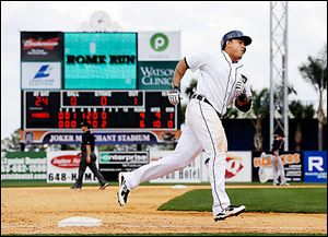 Detroit's Miguel Cabrera rounds third base after hitting a home run against the Yankees.