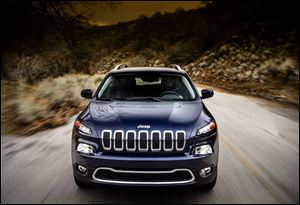 The 2014 Jeep Cherokee Limited is more streamlined, more carlike, more focused on comfort and fuel economy than the previous model.
