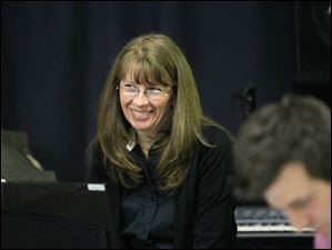 Linda Sankovich of Perrysburg plays piano for the theater.