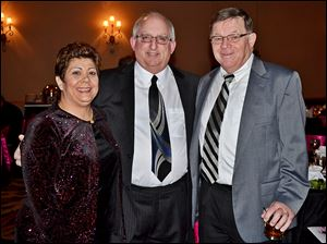 From left, Penny and Ritchie Levine mingle with Don Turner at the Crystal Ball.