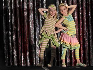 Pearl Thurston, left, and Kiera Lang, both 7, flaunt style as they model children's clothing.