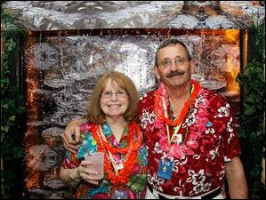 Lynn and Ron Smith of the River View Yacht Club, stand in front of a flowing waterfall near the Bay View Yacht Club's decorated room.