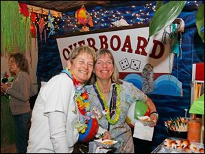 Nancy Horn, of the Ottawa River Yacht Club, left, and Cindy Cherry, of the North Cape Yacht Club, right, at the Associated Yacht Club's 2013 Commodore's Ball.