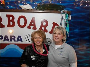 Perrysburg Boat Club members Lady Susie Wagoner, left, and Vice Commodore Marylin Metti, right.