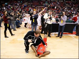 Rogers' Keandre Gilmer (4) lays on the court after losing the Division I State Championship game to Mentor.