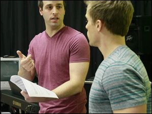 Musical director Michael Kadin Craig, left, and director Clark Ausloos, discuss the performers.