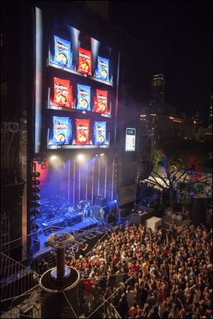 The Latin rock band Chington performs on a giant stage built to resemble  a snack vending machine.