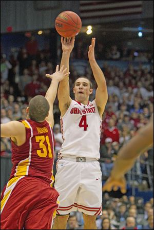 Aaron Craft shoots the game-winning 3-point shot over the outstretched hand of Iowa State's Georges Niang. The Buckeyes will now play Arizona in Los Angeles in the Sweet 16.