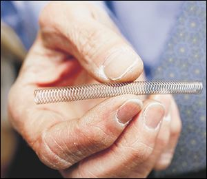 Dr. Mark Burket, UTMC chief cardiologist, holds the Zilver stent for patients with peripheral artery disease.