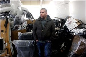 Iraqi immigrant Ubaida Mufrej stands in the office of his car parts export business in Seattle. Mufrej came to the United States under a special visa program for Iraqis who worked with U.S.-led forces during the Iraq War.