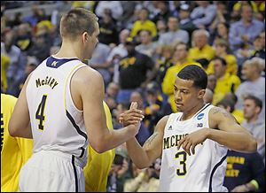 Michigan's Mitch McGary, left, celebrates with guard Trey Burke after their 78-53 win over Virginia Commonwealth on Saturday.