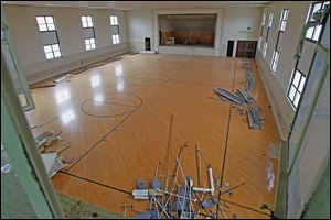 The armory's gymnasium floor is one item that could not be salvaged and will end up in a landfill. It has too many nails and was breaking apart.