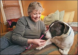 Carol Dunn, founder of Planned Pethood, feeds a treat to O