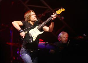 Keith Urban performs at Huntington Center on July 29, 2011. He'll return there for a show on Nov. 24.