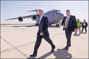 U.S. Secretary of State John Kerry, left, arrives in Baghdad to meet with Iraq's Prime Minister Nouri al-Maliki. Mr. Kerry's Sunday visit was unannounced.