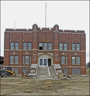 A crew from Green­scape of Lake, Mich., has been removing and salvaging items from the 85-year-old Armory's main build­ing ahead of its demolition this week.