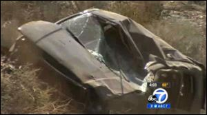 This video frame curtesy KABC TV Los Angeles shows a crash of an SUV in Action, Calif. on Sunday.