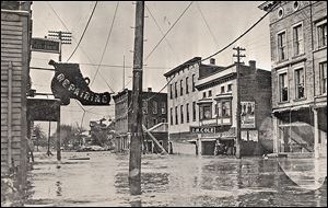 Nineteen people died in Tiffin from the overflowing Sandusky River, which flooded Washington Street, above. The storm started with hurricane-force winds on Good Friday, and the rain started to fall. Because weather predictions were not as sophisticated a century ago, many people decided to wait out the storm.