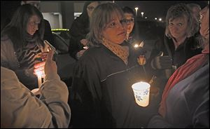 Jenny Gerber cries during the candlelight vigil for her daughter Kaitlin Gerber at the Southland Shopping Center in Toledo, where Miss Gerber was murdered by an estranged former boyfriend.