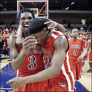 Tony Kynard, left, and Clemmye Owens celebrate after Rogers defeated Brecksville-Broadview Heights in the Division I regional final. The Rams lost in the state championship game.