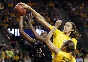 Florida State forward and Waite graduate Natasha Howard has her shot blocked by Baylor's Brittney Griner, right rear, as Alexis Prince, bottom, watches Tuesday in Waco, Texas.